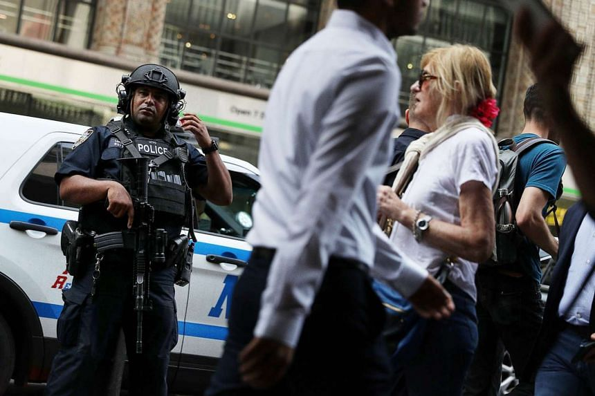 A New York City police officer on guard outside New York City's Grand Central Station this week after a bomb went off at the weekend in the busy neighbourhood of Chelsea. The incident is expected to have an impact on the presidential race in which nationa