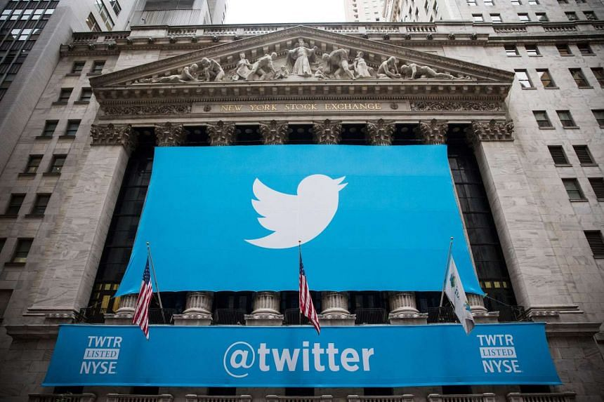 The Twitter logo displayed on a banner outside the New York Stock Exchange (NYSE) on Nov 6, 2013.
