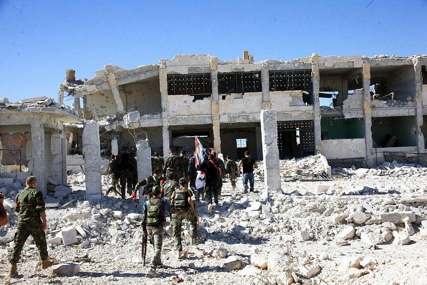 A handout photo showing Syrian soldiers at Handarat camp in the north of Aleppo, Syria on Sept 24, 2016.