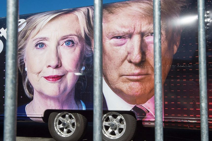 Large images of Democratic nominee Hillary Clinton and Republican nominee Donald Trump are seen on a CNN vehicle on September 24, 2014 in Hempsted, New York.
