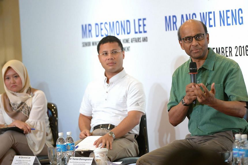 DPM Tharman Shanmugaratnam (right), together with Jurong GRC MP Rahayu Mahzam (left) and Senior Minister of State Desmond Lee speaking at a dialogue at Bukit Batok CC on Sept 25, 2016.