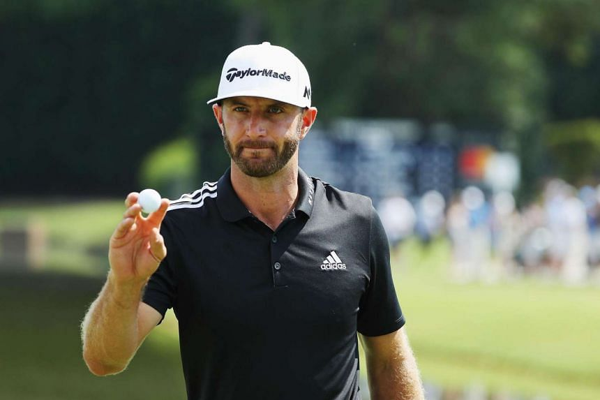 Dustin Johnson makes birdie on the 15th hole during the third round of the Tour Championship at East Lake Golf Club on Sept 24, 2016 in Atlanta, Georgia.