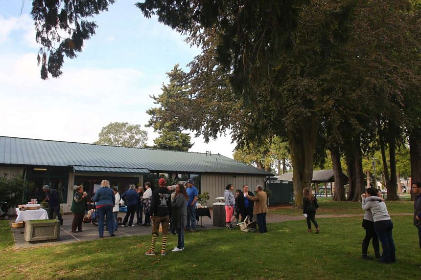 People offering each other support at Maiben Park during an impromptu community gathering on Sept 24, 2016 in Burlington, Washington.