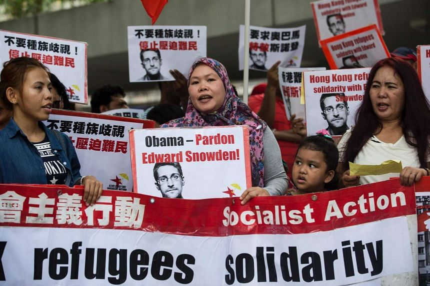 Protesters at the rally calling for a presidential pardon for US whistleblower Edward Snowden and better rights for refugees in Hong Kong, on Sept 25, 2016