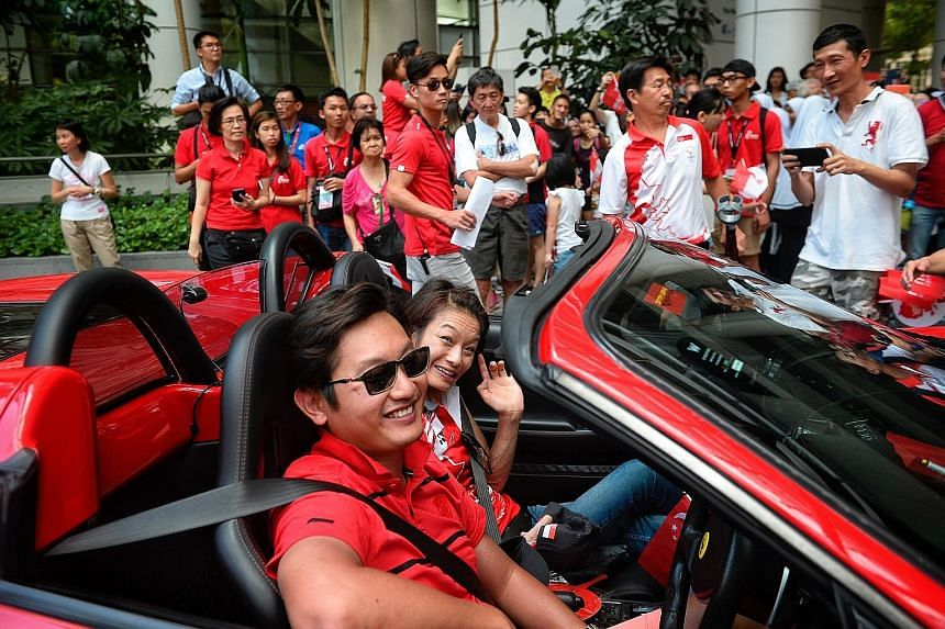 Equestrian para-athlete Laurentia Tan waves as she arrives at the National Library, the second stop of yesterday's Team Singapore celebratory parade for the Rio Paralympians and (below) swimmer Yip Pin Xiu, who won two gold medals in Brazil, en route