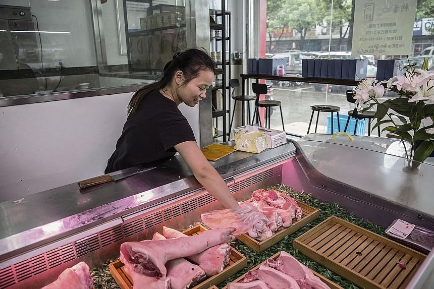 A retail store operated by Mr Shen. The meat sold may be pricier but customers, aware of the dangers of antibiotics, prefer it to regular pork. Mr Shen's antibiotic-free pig farm in Tongxiang, China. The farmer has spent more than $950,000 redesignin