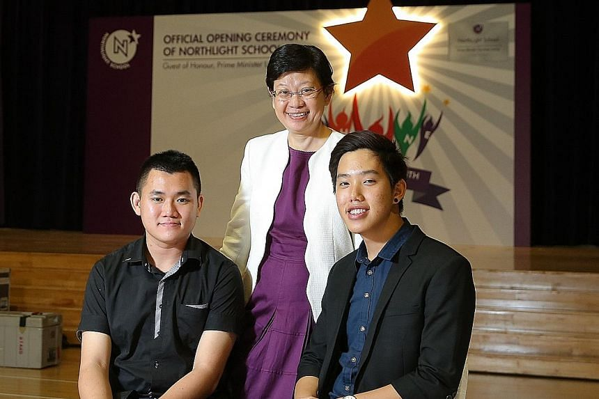 Mr Kenneth Yong (far left) and Mr Eric Zhuo (left) with founding principal of NorthLight School Chua Yen Ching. The former students of NorthLight credit the school for changing their lives.