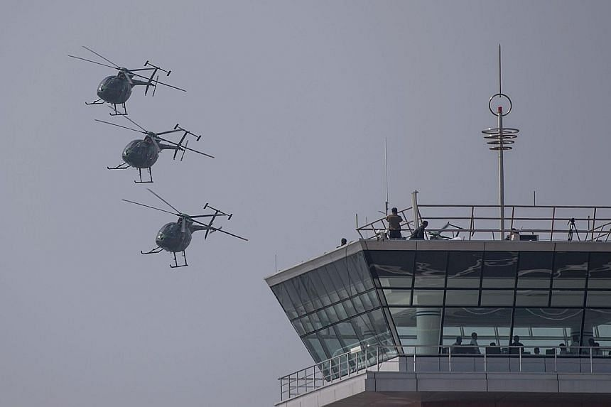 Hughes MD-500 helicopters in a fly-by during the Wonsan International Friendship Air Festival yesterday, North Korea's first public aviation show. Foreign media representatives and several hundred aviation enthusiasts from 20 countries were among the