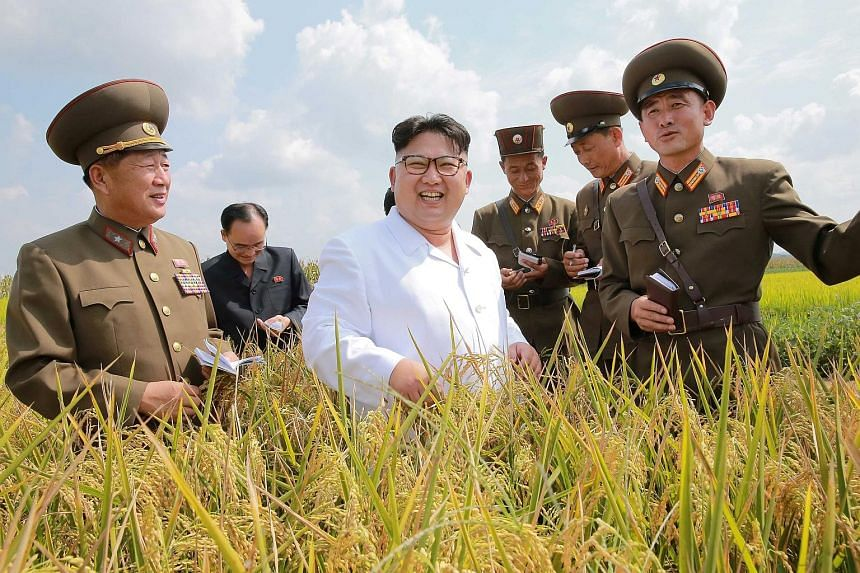 North Korean leader Kim Jong Un with military officials in an undated photo from the Korean Central News Agency in Pyongyang. This year alone, the North has held two nuclear tests and test-fired more than 20 missiles.