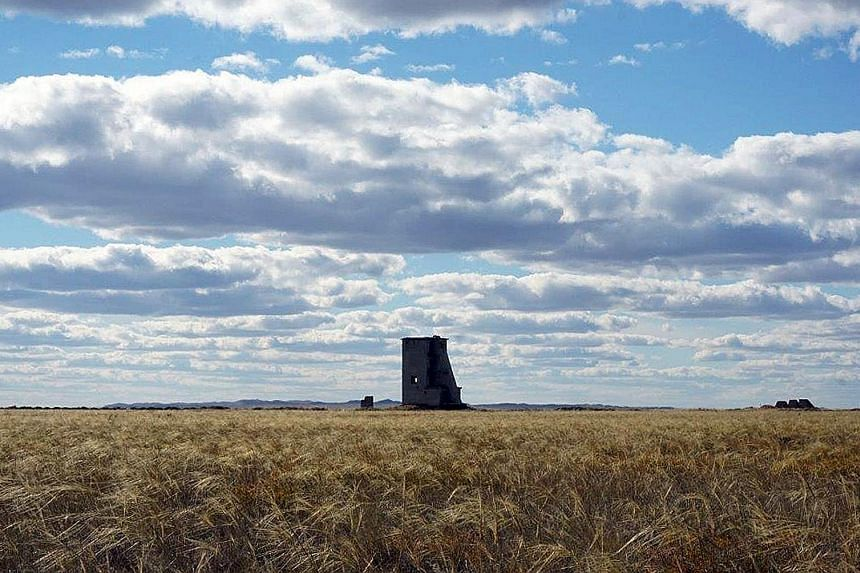 Left: Ms Ela Gandhi (in brown), granddaughter of Mahatma Gandhi, leading a prayer for world peace at the defunct Semipalatinsk nuclear test site. Right: The remnants of a watch tower, from which soldiers and scientists monitored nuclear explosions in