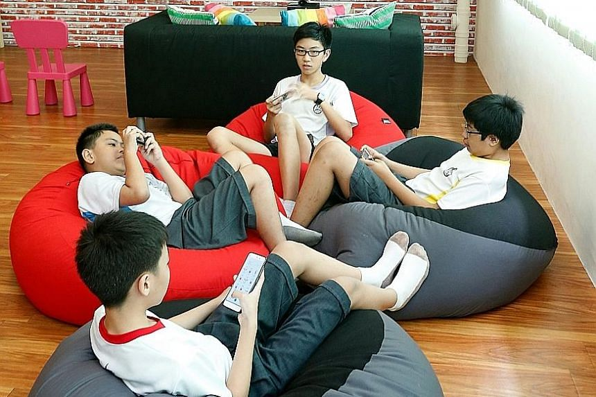 Kent Ridge Secondary School students enjoying the facilities at its after-school centre, KR Lighthouse.