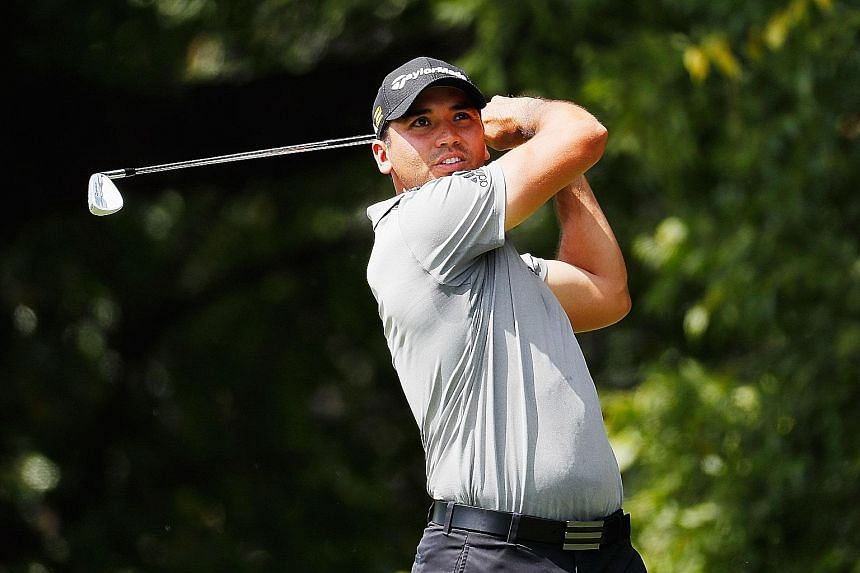 Jason Day hitting his tee shot on the second hole in the Tour Championship's second round. The Australian world No. 1 was playing decently, but withdrew after seven holes at overall three under as a precautionary measure. While he had said earlier th