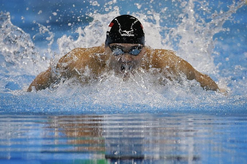 Joseph Schooling on his way to breaking the 100m butterfly Olympic mark in Rio in 50.39sec. While he is serious about targeting Michael Phelps' world record, he sees no need to ramp up the frequency of training just yet.