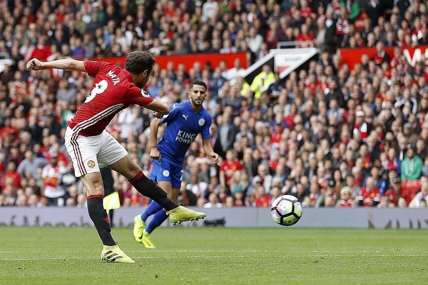 Left: Man of the Match Paul Pogba scoring Manchester United's fourth goal in their 4-1 victory over reigning Premier League champions Leicester yesterday. Below: Juan Mata nets the second goal in United's first-half blitz. United had already beaten L