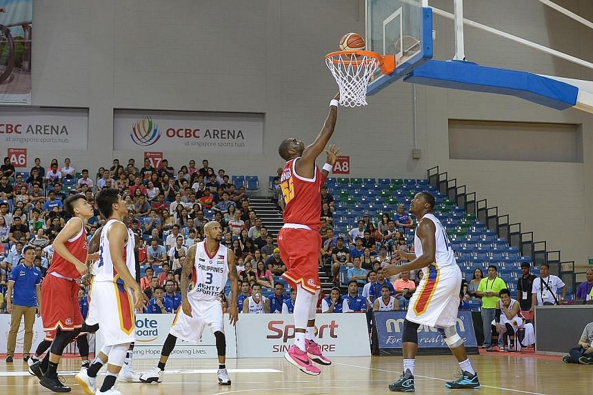 The Singapore Slingers' American centre Justin Howard attempting to score against Philippine side Mighty Sports in their Merlion Cup semi-final game last night. In a thrilling contest at the OCBC Arena, the Slingers fell to a narrow 70-72 loss agains