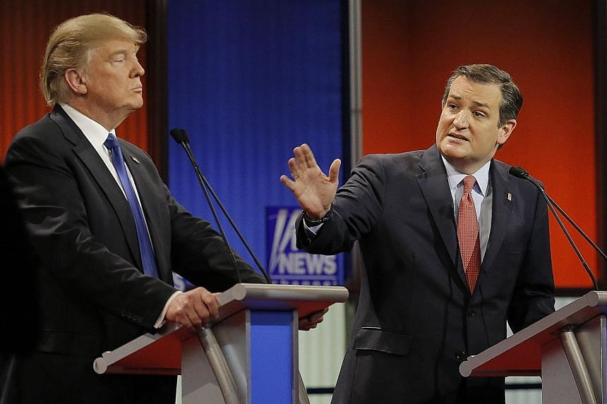 Mr Cruz (right) and Mr Trump at a Republican presidential candidate debate. The primary campaign was a bitter one, and the senator had even refused to endorse Mr Trump at the Republican National Convention.