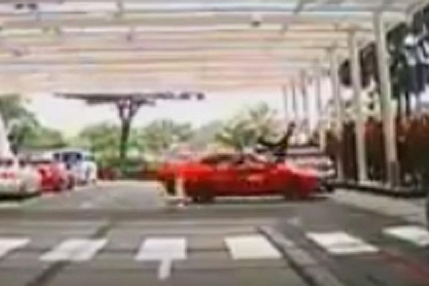A Trans-Cab taxi crashing into an elderly man and sending him flying at Marina Bay Sands yesterday was caught on film by passers-by.