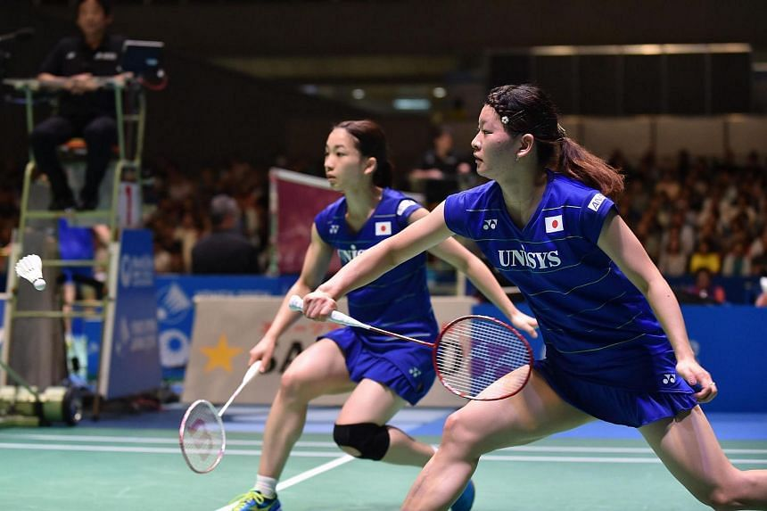 Japan's Ayaka Takahashi (right) and Misaki Matsumoto (left) return a shot during their women's doubles semi-final match at the Japan Open badminton tournament on Sept 24, 2016.