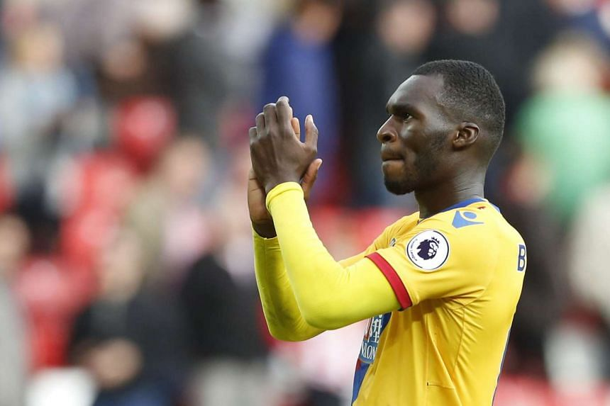 Crystal Palace's Christian Benteke applauds fans as he celebrates at full time.