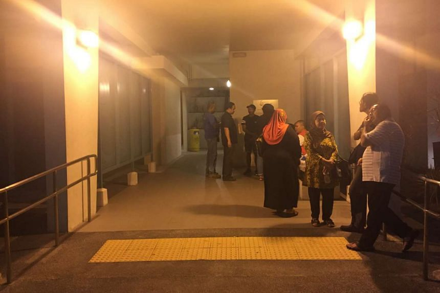 About 15 relatives, including the deceased's wife, were seen at the void deck of Block 152B Bishan Street 11 at about 1am. She later broke down, as relatives hugged her. The 25-year-old man is her younger son, according to a relative who declined to