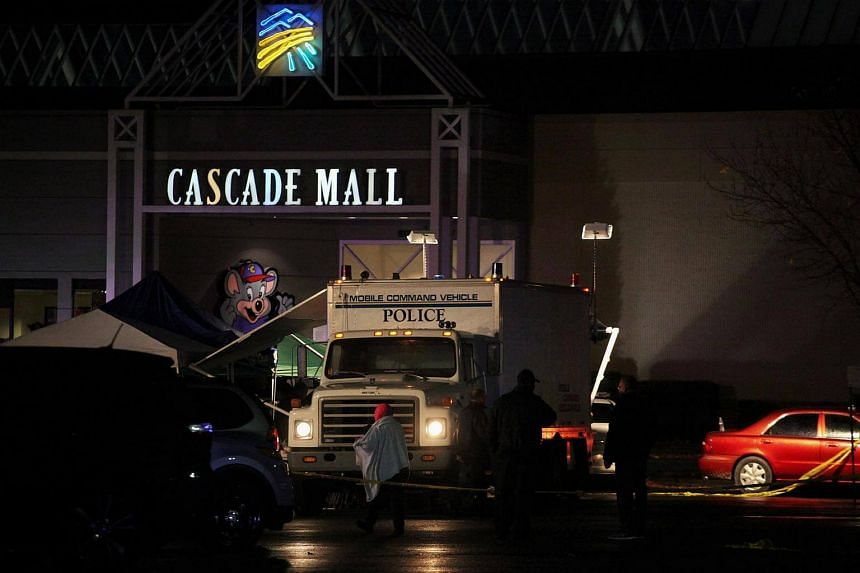 Authorities are pictured at the Cascade Mall following reports of an active shooter in Burlington, Washington, on Sept 24, 2016.