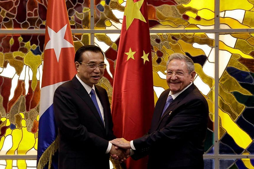 Chinese Premier Li Keqiang (left) shakes hands with Cuba's President Raul Castro during their meeting at Havana's Revolution Palace, Cuba on Sept 24, 2016.