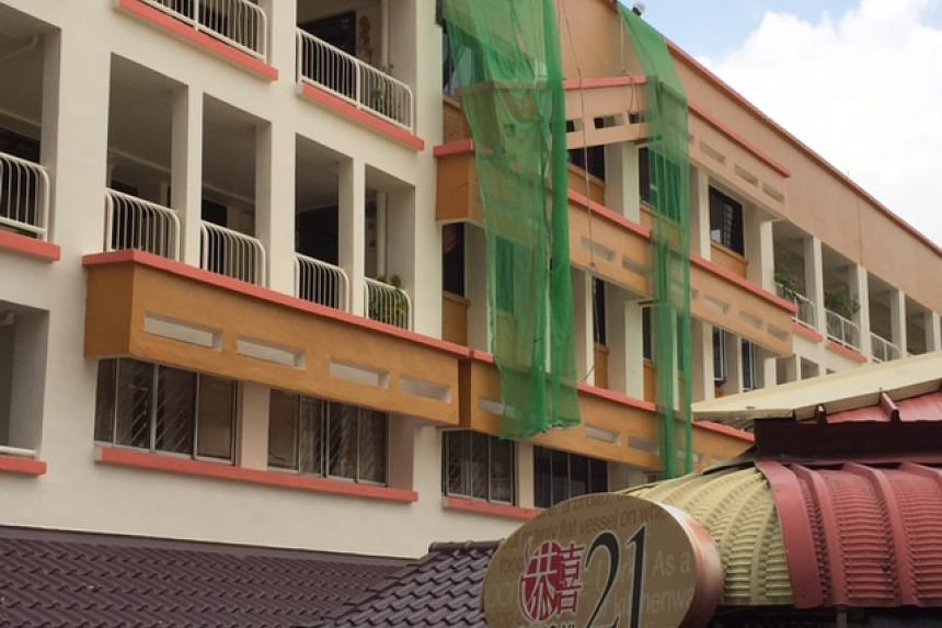 A structural feature on the exterior of a HDB block collapsed on Sunday morning in Tampines.