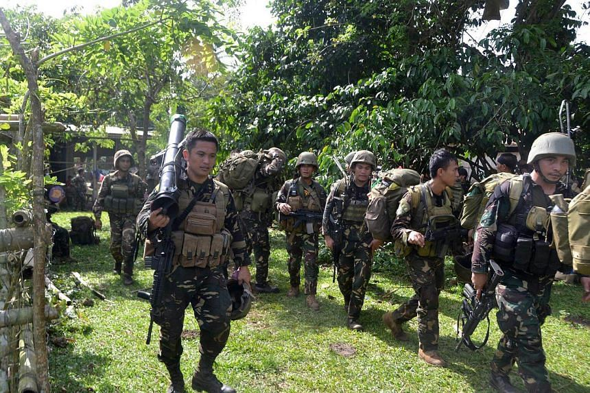 Philippine soldiers arrive at a camp after an armed encounter with members of Abu Sayyaf in Mindanao on Aug 26, 2016.