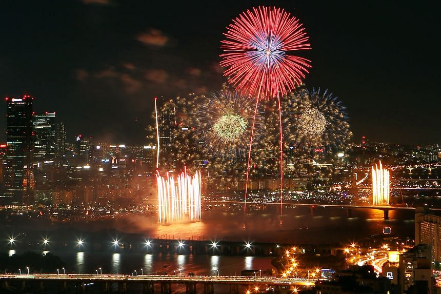 Fireworks (above) against the city backdrop of Seoul during the Seoul International Fireworks Festival.