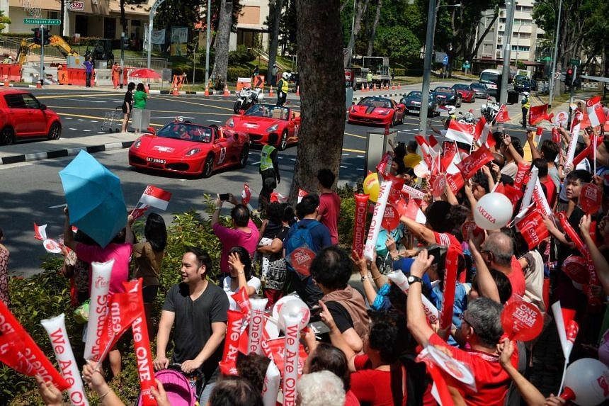 Supporters outside Bradell Heights Community Club cheering the convoy of Rio 2016 Paralympians during the celebratory parade yesterday. The half-day parade, in honour of the Singapore team's best performance at the Paralympics, included the 13-stro