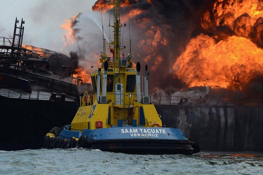 Smoke rises from the ship Burgos, owned by state-run company Pemex, where an explosion occurred.