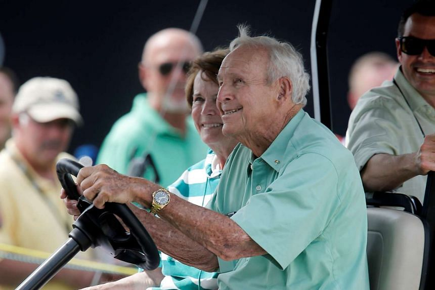 Arnold Palmer (front) and his wife Kathleen Gawthrop drive their golf cart on the eighth hole during the first round of the Arnold Palmer Invitational presented by MasterCard at Bay Hill Club and Lodge, on March 17, 2016.