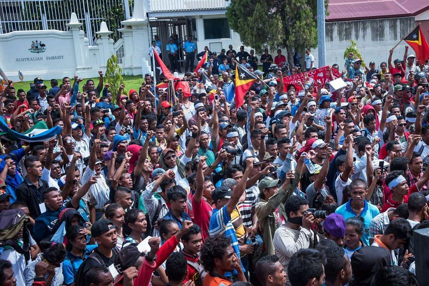 East Timorese activists attending a rally outside the Australian embassy in Dili on Feb 23, 2016.