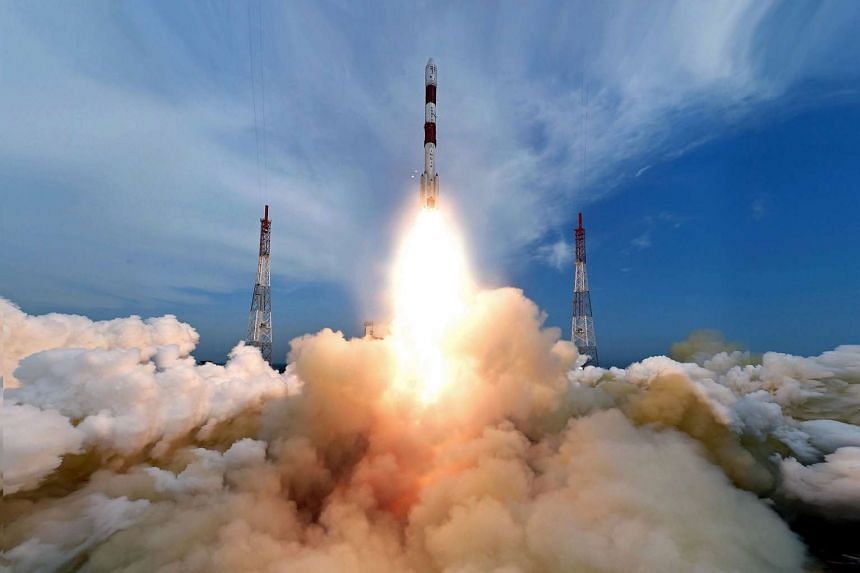 A handout photo shows the fully integrated PSLV-C35 taking off from the launch pad at Sriharikota's Satish Dhawan Space Centre in Andhra Pradesh, India on Sept 26, 2016.