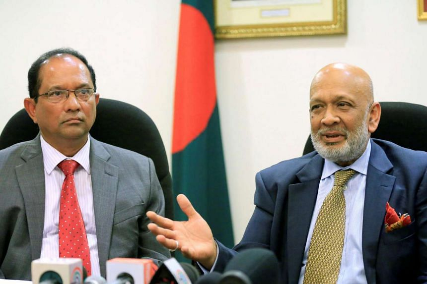 Bangladesh Bank lawyer Ajmalul Hossain (right) gestures with John Gomes, Bangladesh ambassador to the Philippines, during a press conference at the Bangladesh embassy in Makati city,