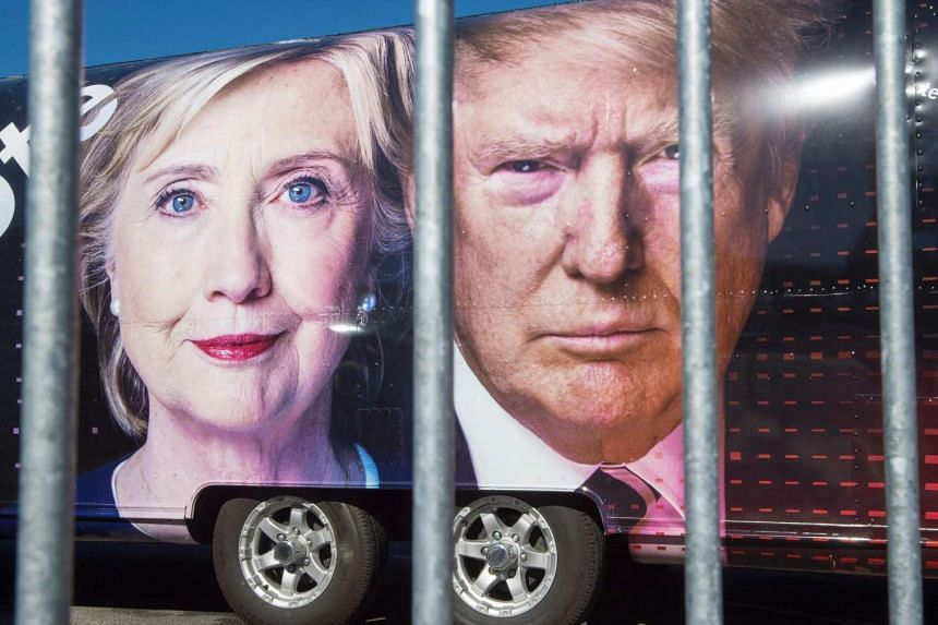 Images of US Democratic nominee Hillary Clinton and Republican nominee Donald Trump are seen on a CNN vehicle, on Sept 24, 2014, at Hofstra University, in Hempstead, New York.
