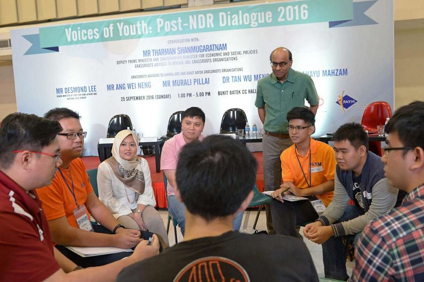 Mr Tharman and Jurong GRC MP Rahayu Mahzam (third from left) at a small group discussion with young people yesterday.