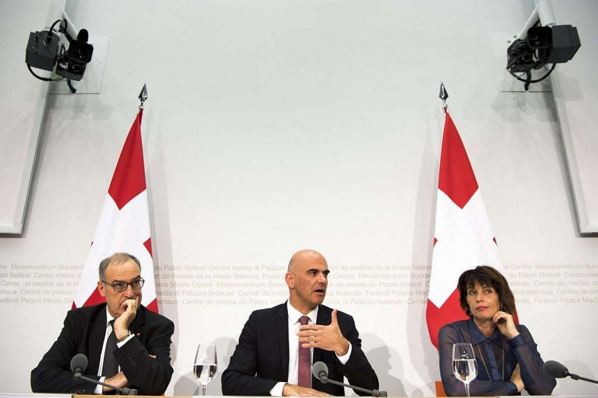 Swiss Minister of Defence Guy Parmelin, Interior Minister Alain Berset and Minister for Environment, Traffic and Energy Doris Leuthard speak at the media conference in Bern on Sept 25, 2016.