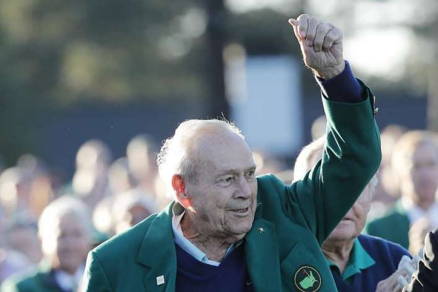 Honourary starter Arnold Palmer reacting to patrons on the first tee after arriving to ceremonially open the first round of the 2016 Masters Tournament in Augusta, Georgia, US, on April 7, 2016.