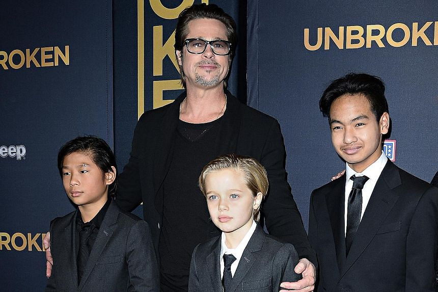 Actor Brad Pitt with his children (from far left) Pax, Shiloh and Maddox in 2014.