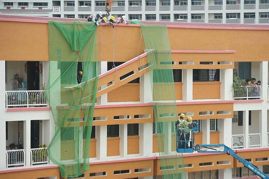 A concrete sunshade was partially dislodged and left balancing on the exterior of Block 201E, Tampines Street 23 yesterday morning. One end of the sunshade, on the fourth floor of the block, crashed down onto a sunshade on the floor below. While the