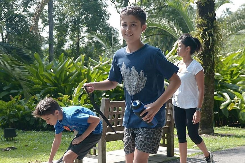 From left: Kieran O'Rourke, 10, his brother Tiernan, 12, and their mother Emily Mathews, 38, enjoying some time outdoors. Ms Mathews has been investing time and money in getting her sons involved in sports such as rugby and mixed martial arts.
