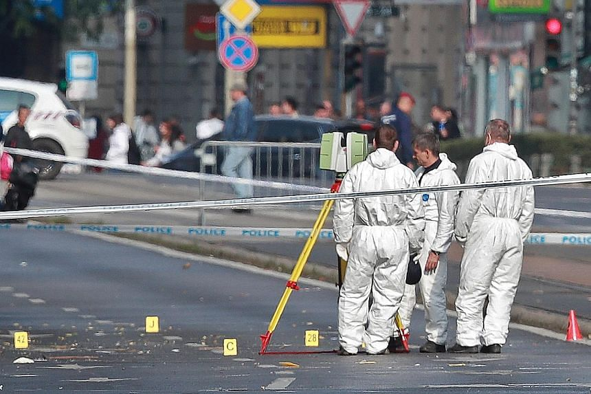 Hungarian police officials at the scene of an explosion of unknown origin in Budapest on Saturday. A government spokesman would not say if the blast was a deliberate attack.