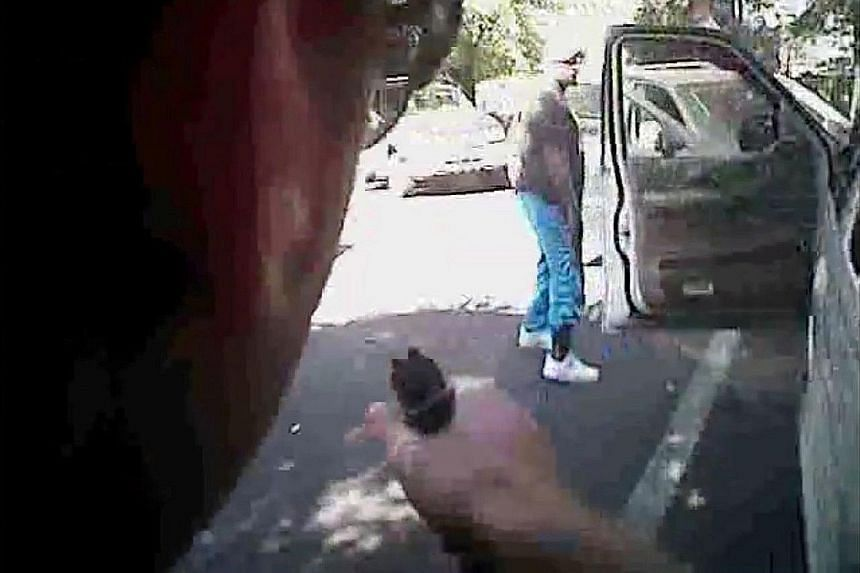 The body and dashboard camera videos released by the authorities on Saturday appear to show Mr Scott getting out of a white sport utility vehicle and backing away with his hands by his sides. No gun can be seen on Mr Scott in the videos, corroboratin