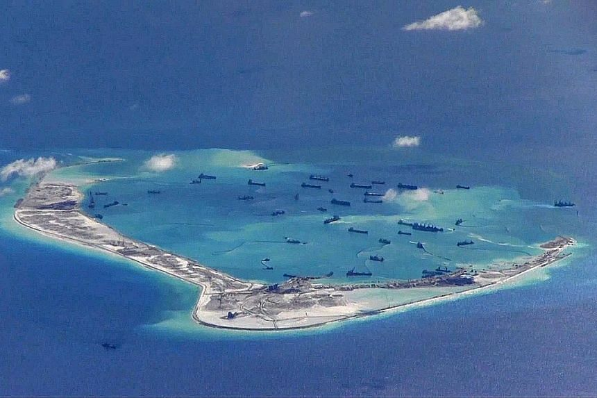 A photo provided by the US military showing what are described as Chinese dredging vessels in the waters around Mischief Reef in the disputed Spratly Islands.