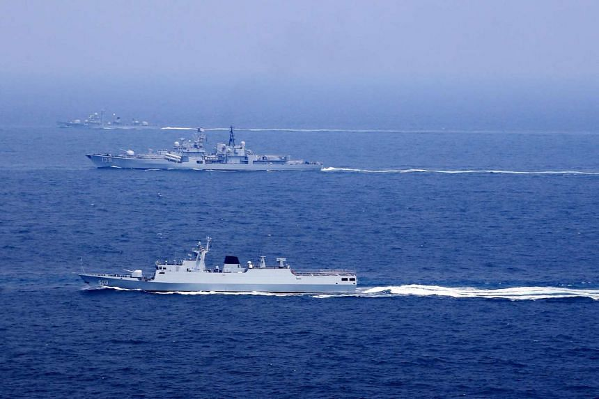 Chinese naval vessels participate in a drill on the East China Sea, China on Aug 1, 2016.
