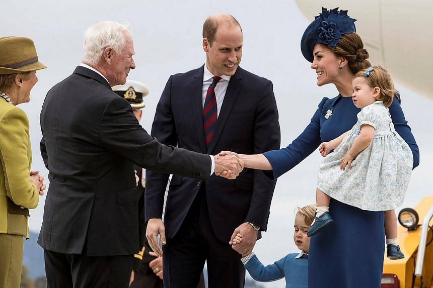 Britain's Prince William, the Duchess of Cambridge, Prince George and Princess Charlotte are greeted by Mr David Johnston, the Governor-General of Canada, at the Victoria International Airport in  Canada on Sept 24, 2016.