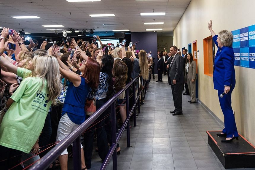 Hillary Clinton supporters taking a selfie with her on Sept 21, 2016.