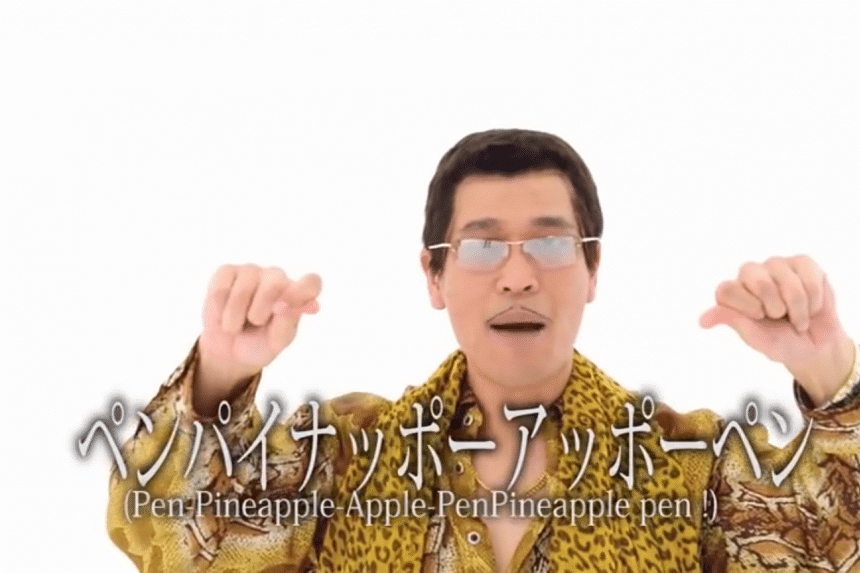 Daimaou as his character Piko-Taro, performing Pen-Pineapple-Apple-Pen.