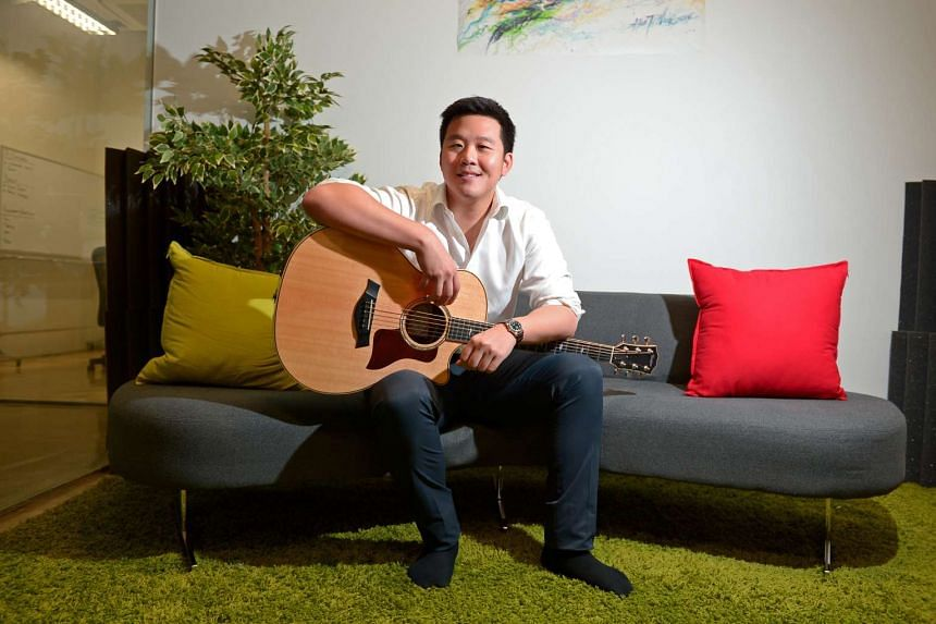 BandLab founder Kuok Meng Ru strums a guitar in a July 18 (2016) photo.